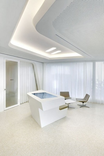 Contemporary_bank_desk_with_stylish_and_clean_lines-Modern Bank Interior  Design - Raiffeisen in Zurich