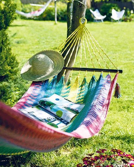 Cozy atmopshere in hammock– a home garden lounge zone