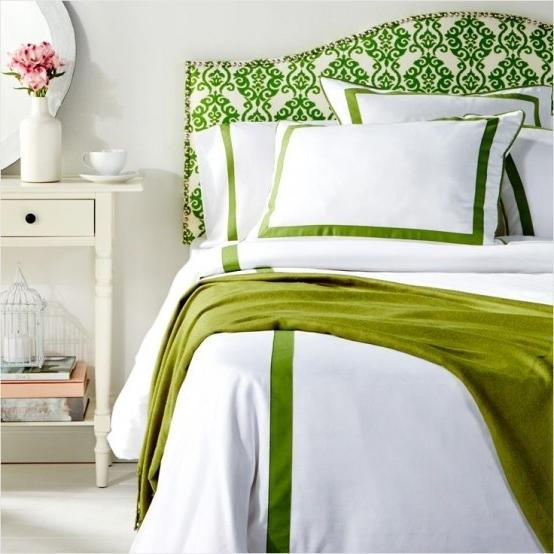 Cozy master bedroom with green accents on the pillows and the bed sheets