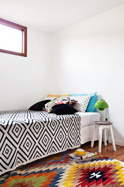 Creative small bedroom with graphic accents