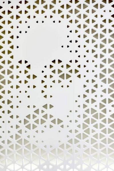 Digitally_perforated_wall_with_portrait-Modern Bank Interior Design - Raiffeisen in Zurich