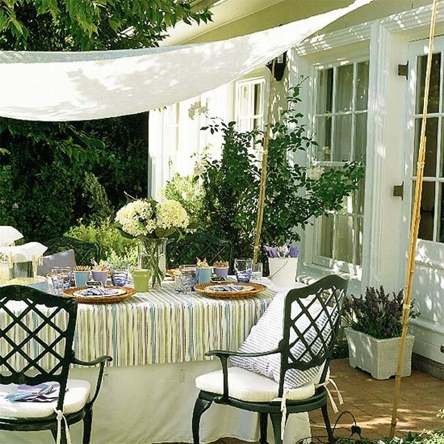 Dinning table and chairs placed in front of the house- Ideas for home outdoor spaces