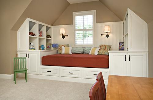 Functional kids room design with red bed and white cupboards
