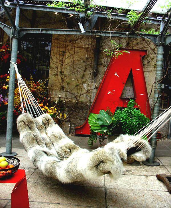 Furred hammock placed outsides– a home garden lounge zone