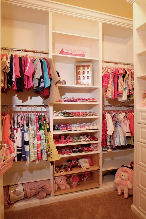 Girly kids storage room with pink clothes