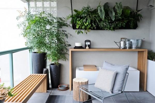 Green plants and high flower pots in a small balcony-Splendid mini home garden