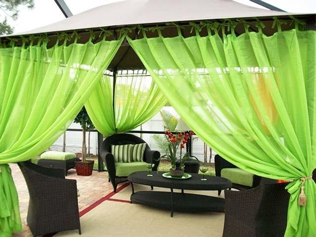 Green tent with rattan furniture- Ideas for home outdoor spaces