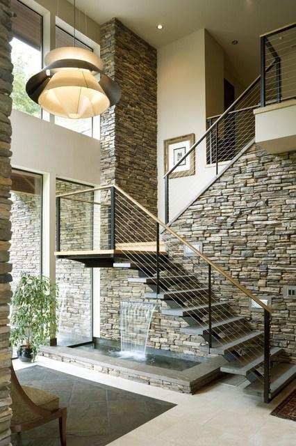 Home staircaise in a stylish house with stone walls