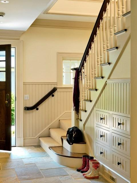Home staircase in the entry hall that leads to the second floor