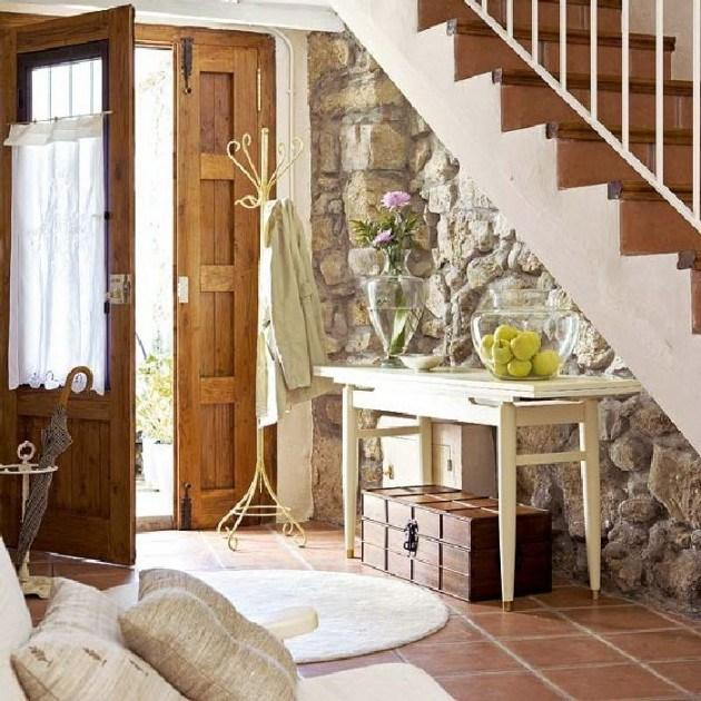 Home staircase with a vintage table beneath it