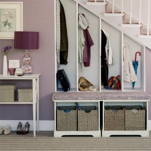 Home staircase with clothes storage placed below it