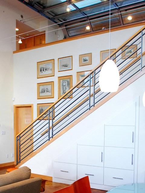 Home staircase with white drawers beneath it