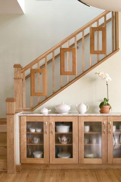 Home staircase with wooden railings and floor