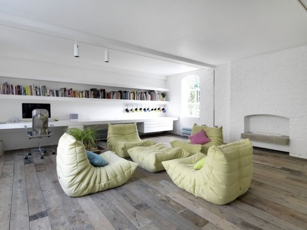 Livign room with green furniture-Luxurious minimalist loft interior design