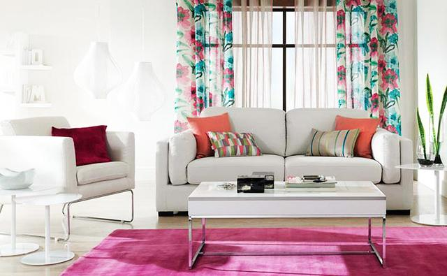 Living room interior with colorful curtains and comfortable furniture