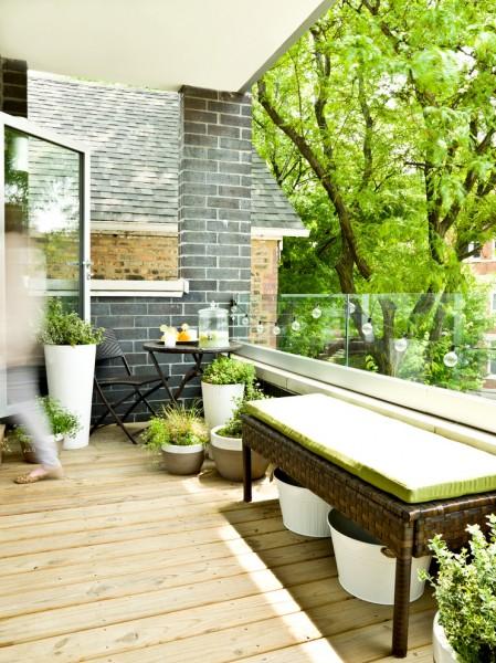 Low-in-height flowers on a wooden deck balcony-Splendid mini home garden