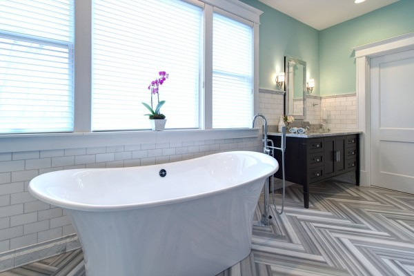 Luxurious bath tub in the middle of the room- Modern Art Deco Bathroom Design in a Victorian Home