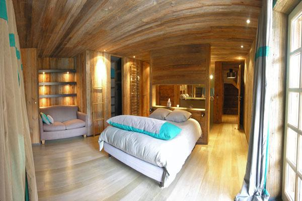 Master bedroom in a wooden-inspired home with a lot of sunlight