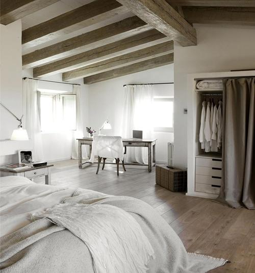 Master bedroom in rustic interior design style with barn beams