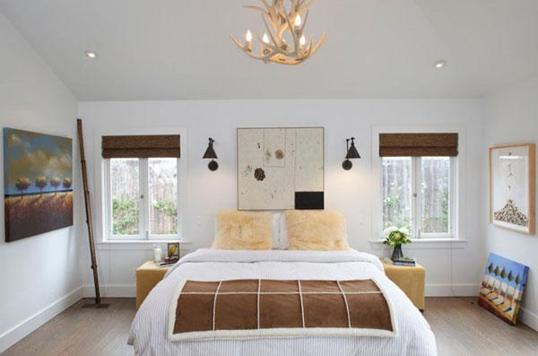 Master bedroom with moderate bed and two windows on its both ...