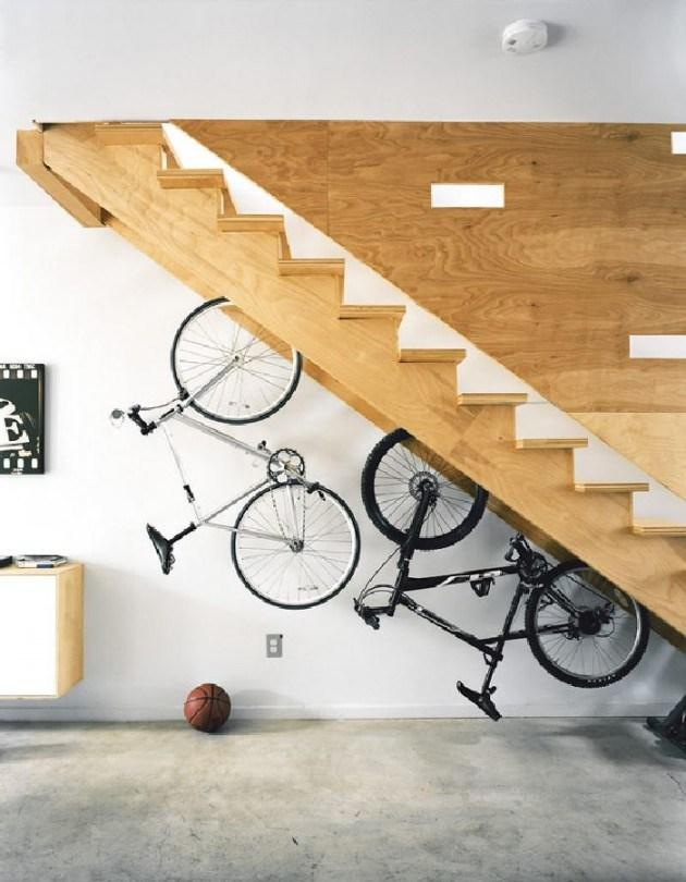 Modern home staircase with bike hangers below it