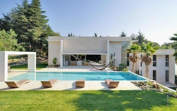Outdoor pool with lounge chairs -Minimalist Villa in France