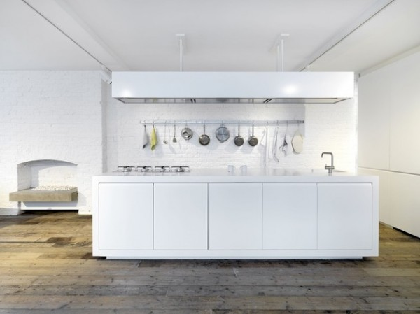 Polished white kitchen island-Luxurious minimalist loft interior design