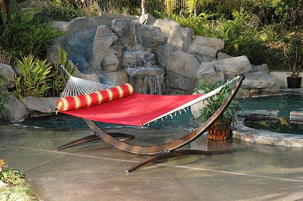 Red hammock near the pool– a home garden lounge zone