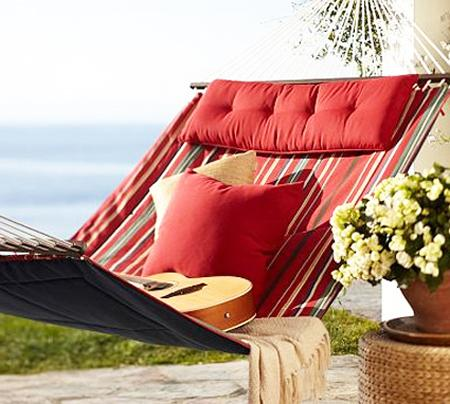 Red hammock overviewing the ocean– a home garden lounge zone