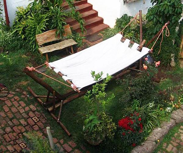 Relaxing swing outside the house– a home garden lounge zone