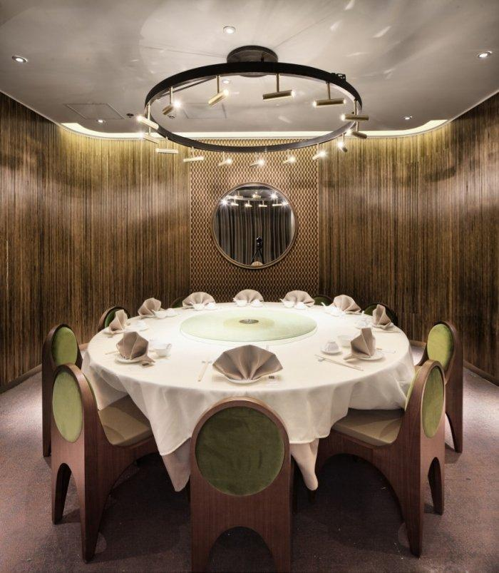 Restaurant architecture - round table for ten and amazing chandelier above