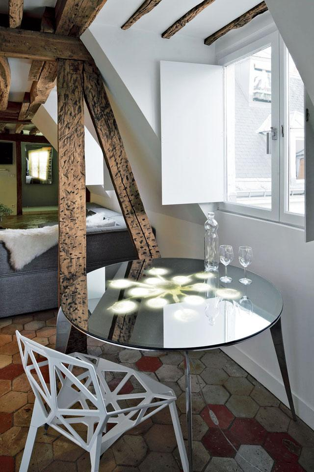 Rounded glass table and modern chair- Apartment Interior Design in Paris