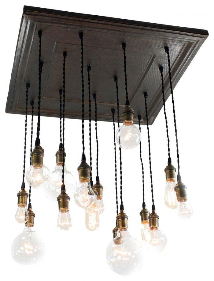 Rustic chandelier with copper elements– worn-out effects on furniture