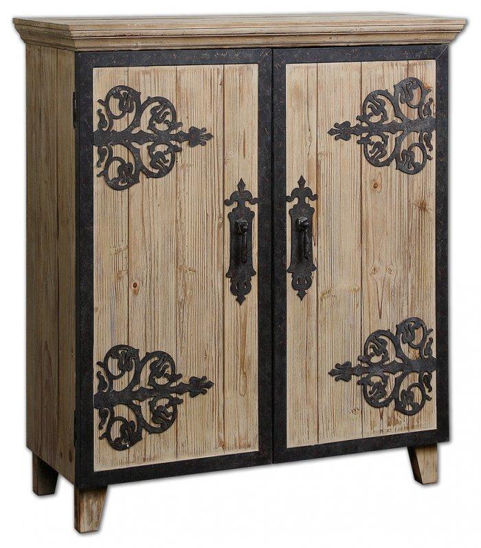 Rustic cupboard with wrought iron handles– worn-out effects on furniture