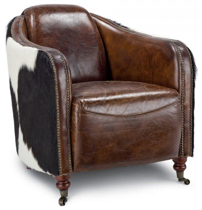 Rustic leather armchair with furred back– worn-out effects on furniture
