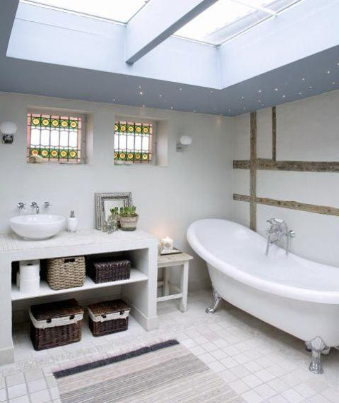 Scandinavian bathroom with white tub