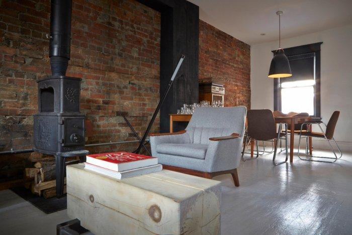 Simple living room with exposed bricks- inside a small eclectic house