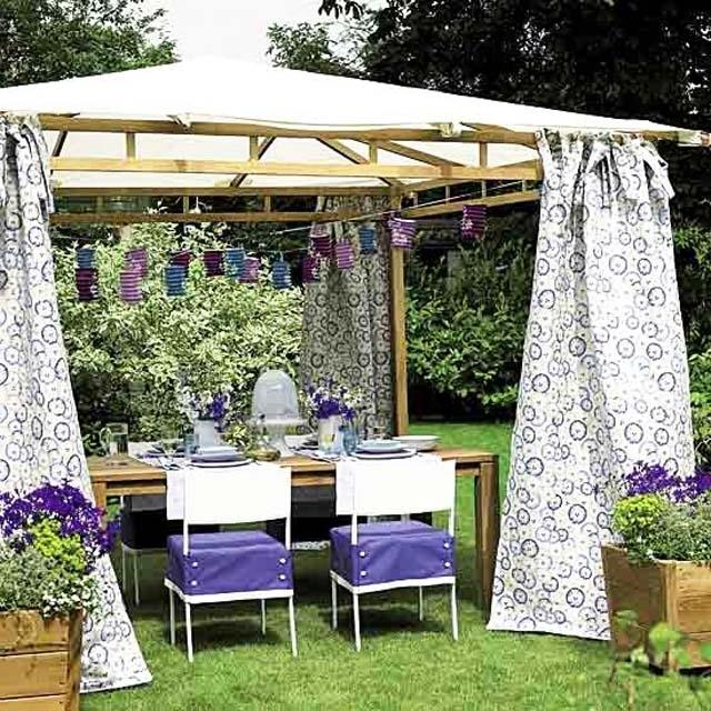 Small pergola and chairs and table beneath- Ideas for home outdoor spaces