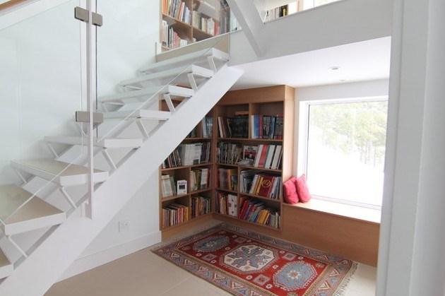 Small white home staircase leading to the second floor