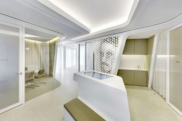 Small kitchen hidden behind one of the perforated walls - Modern Bank Interior Design - Raiffeisen in Zurich
