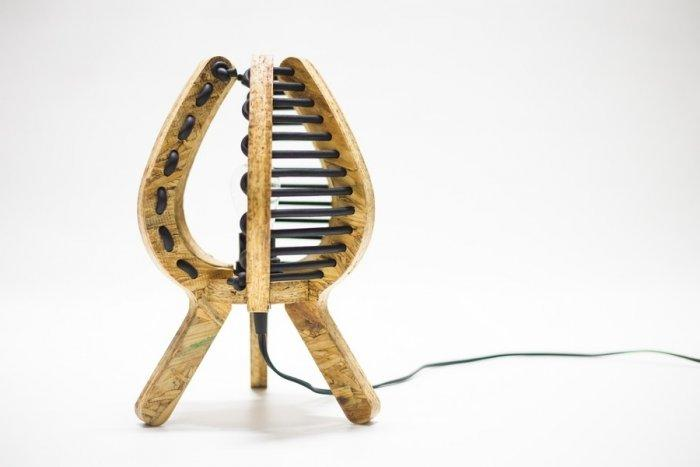 Stylish modern lamp made of wood and rubber