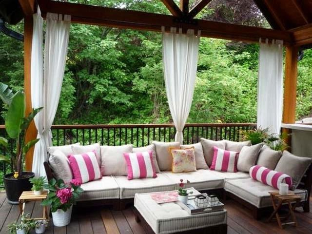 Summer veranda on the wooden deck- Ideas for home outdoor spaces