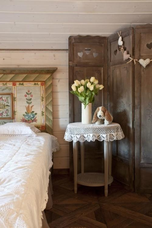 Summer villa - cozy bedroom with vintage wooden accents and tulips for decoration