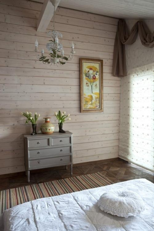 Summer villa - small cozy bedroom decorated with flowers and vintage wall art