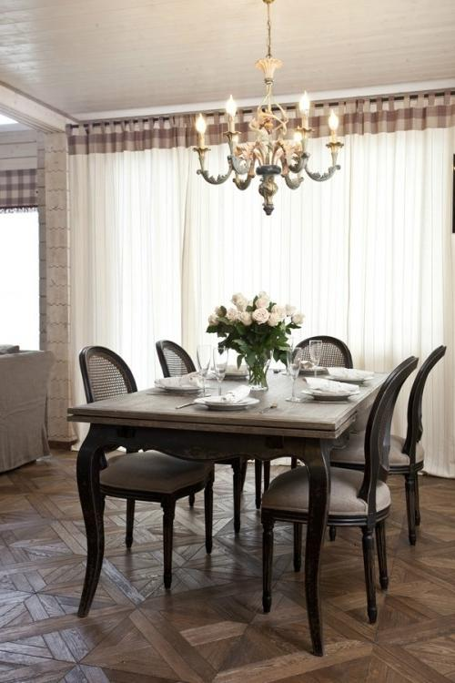 Summer villa - traditional dining room with solid table and chandelier above it
