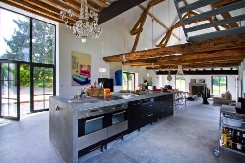 Summer villa with ultra modern open plan kitchen and rustic barn beams