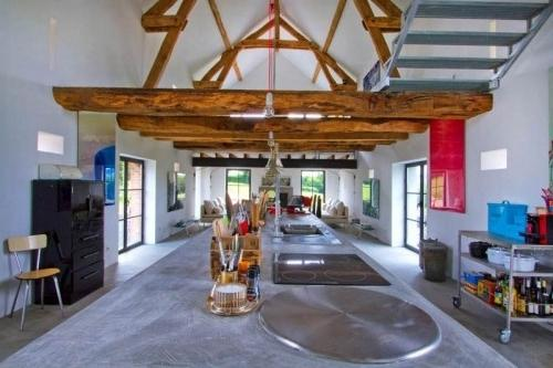 Summer villa with ultra modern open space and rustic barn beams on the ceiling