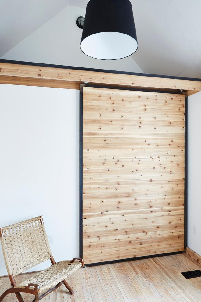 The wardrobe's wooden sliding door- inside a small eclectic house