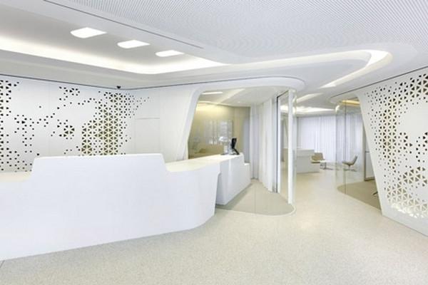 The_reception_desk_with_perforated_white_walls-Modern Bank Interior Design - Raiffeisen in Zurich