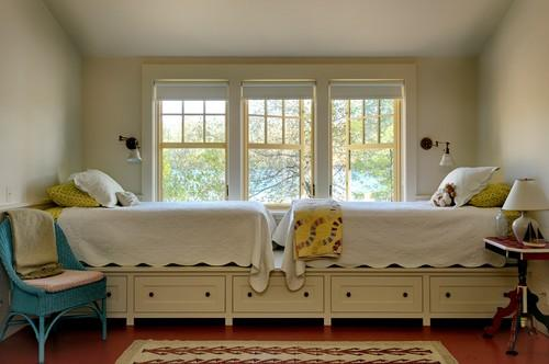 Traditional kids room design with two beds near the window